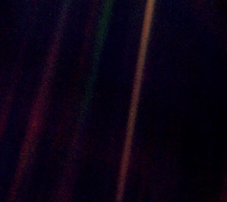 The pale blue dot, about half way down in the right hand band is the Earth from Voyager 1, Carl Sagan had this picture taken. This picture was taken some 6.4 Billion Kilometers from Earth.